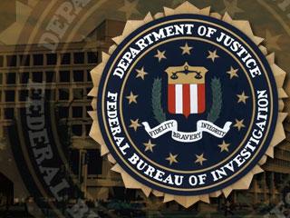 """Le logo du FBI et le devise du service : """"Fidelity, Bravery and Integrity"""""""