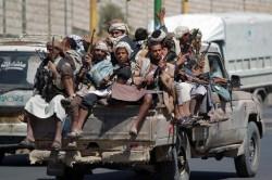 Des rebelles chiites lors de la prise de Sanaa