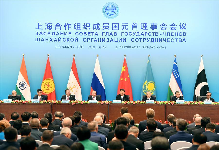Les dirigeants des États membres de l'Organisation de coopération de Shanghai (OCS) se sont rencontrés à Qingdao en Chine le 10 juin 2018.