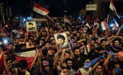 militants sadristes célébrant la victoire électorale du camp de Moqtada al-Sadr en Irak